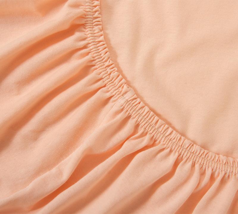 Простыня на резинке Персиковый, размер 140х200 смПростыни<br>Плотность ткани: 120 г/кв. м <br>Высота матраса: 20 см<br><br>Тип: Простыня на резинке<br>Размер: 140х200<br>Материал: Кулирка