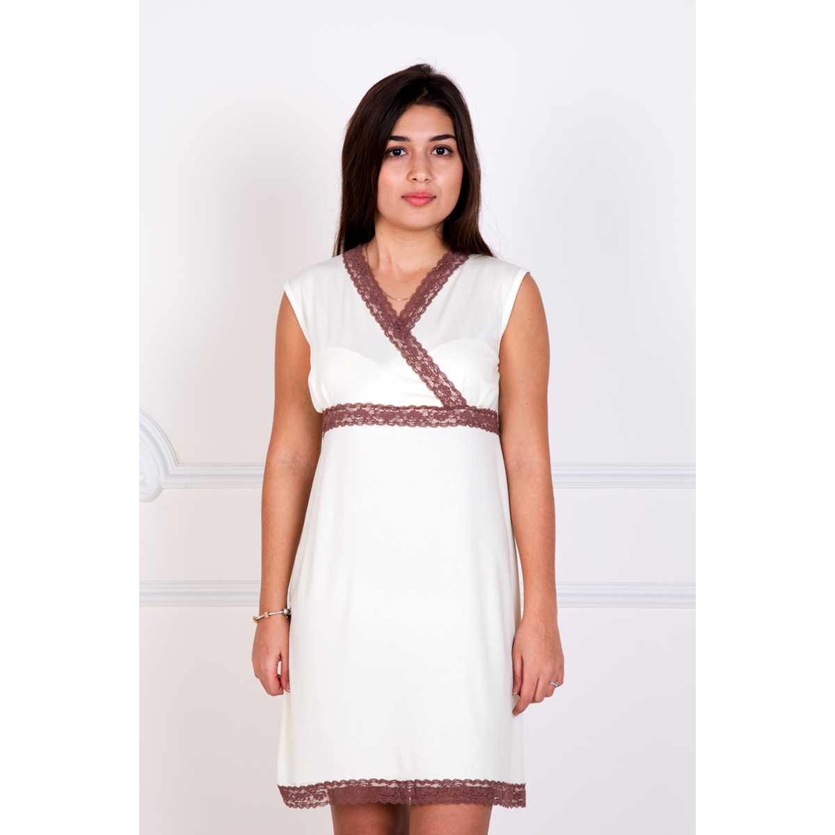 Женская сорочка Элегант Кремовый, размер 54Ночные сорочки<br>Обхват груди: 108 см <br>Обхват талии: 88 см <br>Обхват бедер: 116 см <br>Рост: 167 см<br><br>Тип: Жен. сорочка<br>Размер: 54<br>Материал: Вискоза