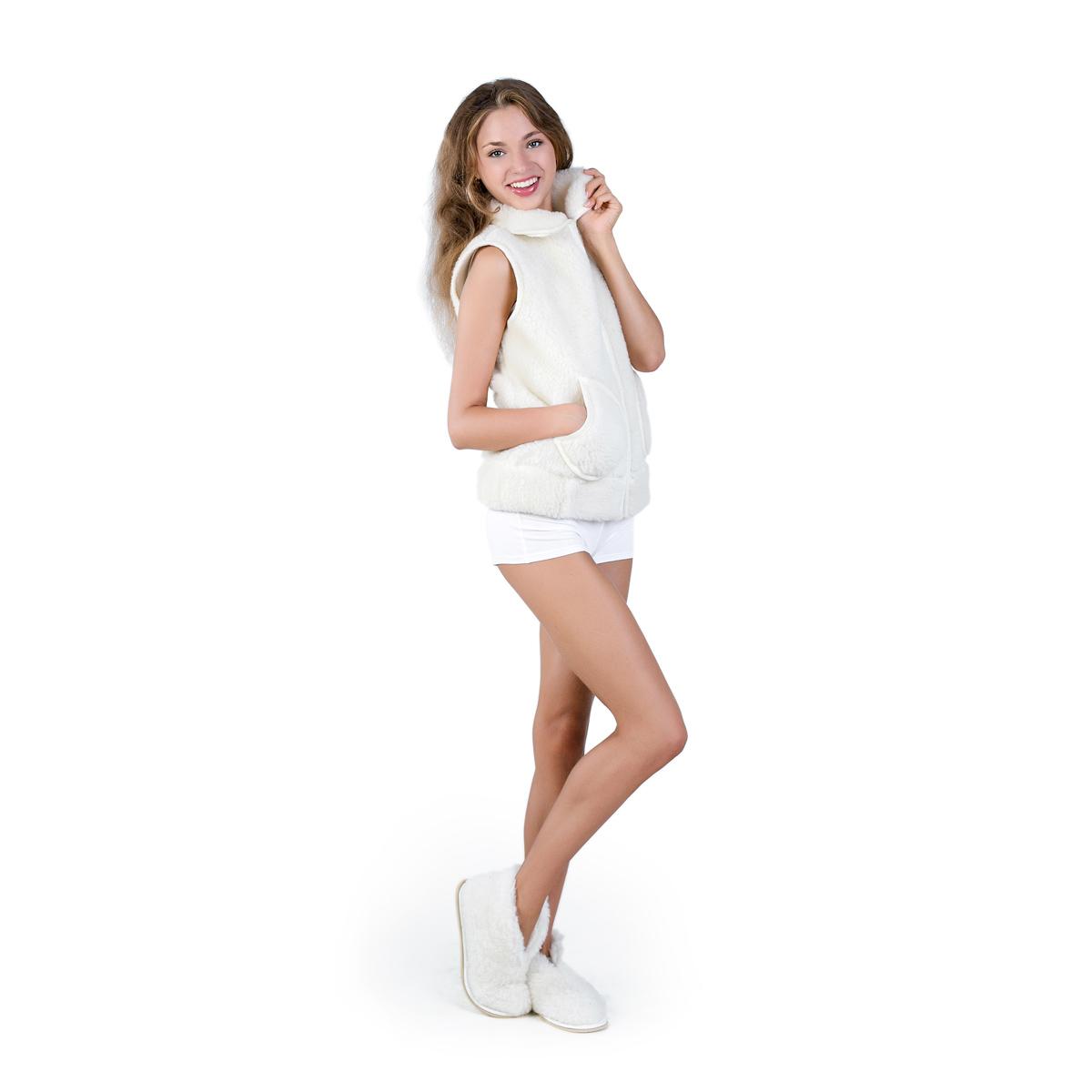 Жен. жилет Модный Белый р. 56Согревающий<br>Обхват груди:112 см<br>Обхват талии:95 см<br>Обхват бедер:120 см<br>Длина по спинке:63 см<br>Рост:164-170 см<br><br>Тип: Жен. жилет<br>Размер: 56<br>Материал: Овечья шерсть