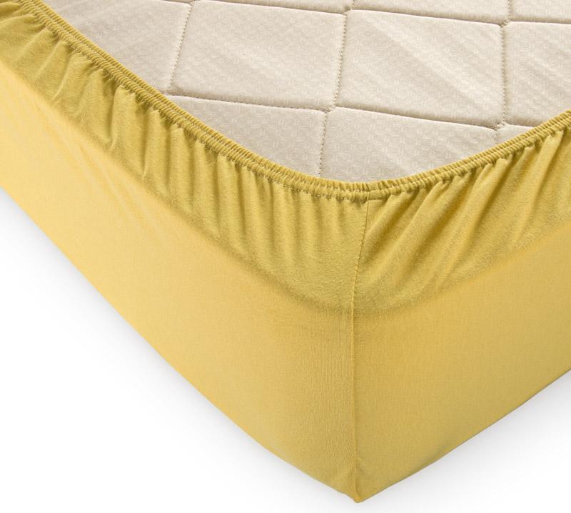 Простыня на резинке Горчица р. 180х200Простыни<br>Плотность ткани: 120 г/кв. м <br>Высота матраса: 20 см<br><br>Тип: Простыня на резинке<br>Размер: 180х200<br>Материал: Кулирка